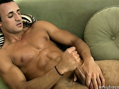 Lying on the couch, the young girder jerks his big cock until he enjoys intense pleasure