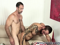 Tattooed hunk gets a bum full of cum foreign his hung sex-friend