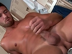 Hot guy strokes his uncut cock give a vengeance