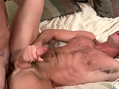 Two hot hairy guys have anal sex and cum