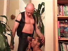 Deepthroat cocksucking video with leather hottie