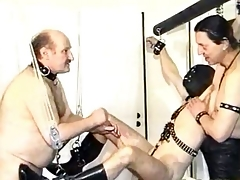 Uncivilized masked slave gets his cock and balls tortured