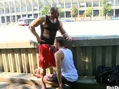 Sexy bodybuilder allows his friend to make blowjob on the street