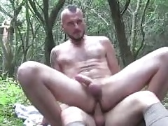Two horny guys sucking again others cocks deep in the woods