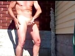 Mature amateur dude rubbing his dick in the driveway