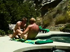 Gays sunbathe and suck on a dick before he pumps a tight ass