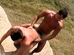 Muscled young guy bends over to let in a vicious rod of pleasure